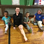Jessica and the Discovery Club students show off their flexibility.