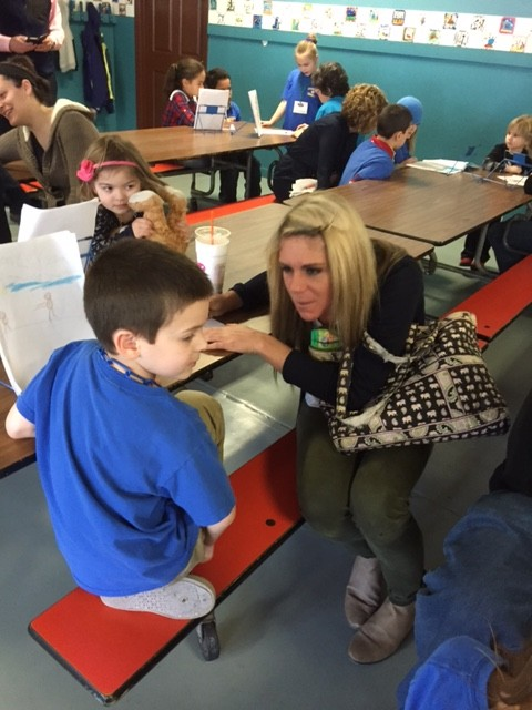Ms. Hostetter listens and responds to Jason's story.